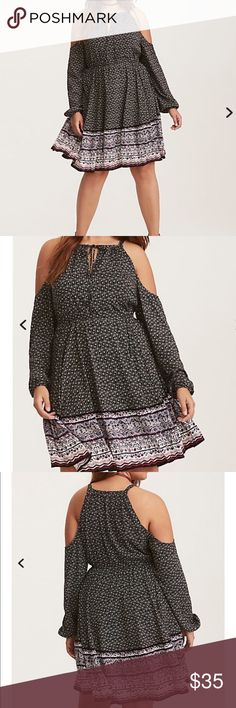 NWT torrid size 4 cold shoulder challis dress NWT torrid size 4 cold shoulder challis dress. Start setting up your out-of-office replies now. Lightweight, silky and effortless black challis comes to life with a vacay-approved multi-color border print. Cold shoulder cutouts and a tie front flaunt some skin. Challis fabricKeyhole tie high neckLong gathered sleevesStretch waist torrid Dresses