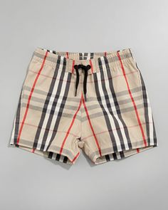 Imagine the photo ops in a pair of tiny Burberry swim trunks.