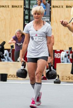 This woman is Betsy Finley. She's over 60 years old and carrying about 50lbs in each hand. She won the 2011 CrossFit games in her age class. That is one kickass woman.