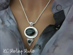 black banded agate and onyx sterling silver metalsmith pendant necklace by kcsterlingstudio on Etsy https://www.etsy.com/listing/233754435/black-banded-agate-and-onyx-sterling