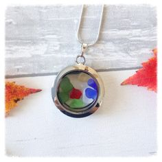 Beautiful Glass Locket with mini pieces of Sea Glass Truely one of a kind On an 18 chain  This unique piece is a perfect representation of Nova Scotia, Canadas Ocean Playground.  Each piece is 100% unique , made with genuine sea glass. The glass has not been altered in anyway and is exactly as it was picked along the shores of our beautiful coast line. 💙 Made with Love 💙