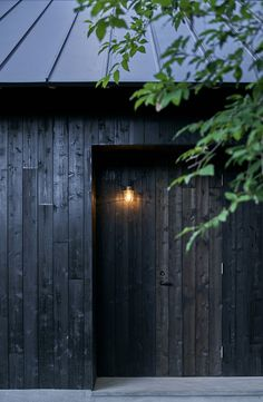 mori no terrace designs a subtle cafe amongst a luscious and green campsite in osaka japanese design studio mori no terrace has created a camping café called 'terrace of the forest' using locally sourced material in osaka, japan. Timber Cladding, Exterior Cladding, Black House Exterior, Interior And Exterior, Terrasse Design, Pavillion, Japan Garden, Black Barn, Garden Studio