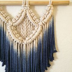 Indigo was hand made be me from 1 birch dowel and 3 stranded cotton cord. I hand-dyed the cord an Indigo ombre. This modern macrame wall hanging is perfect to bring warmth, color and texture to any home. Measures: 21 width ( birch dowel) 23 length (dowel to bottom)
