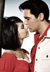 In Kissin' Cousins, Elvis sings nine songs while playing two roles in a Li'l Abner style film that became the model for the rest of his Hollywood career