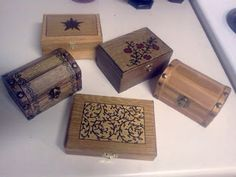 Inexpensive craft store boxes w/ wood stain and/or sharpie, then sealed
