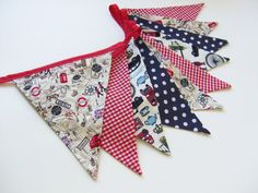 British Bunting featuring the map of London, the queen's guards, union jacks, red telephone boxes, teapots and more! A must for all anglophiles! www.nessafoye.etsy.com