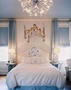 White & blue #bedroom with chandelier mural behind a contemporary #light fixture