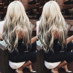 Long platinum blonde hair with dark underneath lowlights