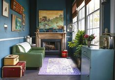 painted beadboard sunroom with green vinyl loveseat, old suitcases and vintage metal cabinet | The Beautifully Strange World of Miranda Lake — House Tour | Apartment Therapy