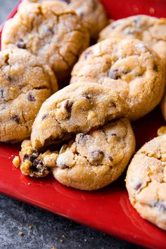 Here's how to make big bakery-style peanut butter chunk cookies right at home! They're thick, soft, very addicting, and filled with chocolate chips!