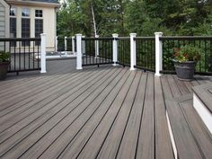 This+sunken+hot+tub+blends+perfectly+with+the+surrounding+contemporary,+gray+decking.