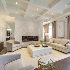 khl.ca   Waffle ceiling, dramatic fireplace with marble face and mirrors on each side are very important features that make this room as gorgeous as it is. Of course our bespoke upholstery are the finishing touch #livingrooms #ceilings #fireplaces .