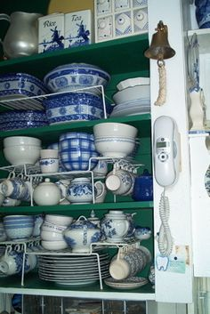 collections of blue and white china, a cupboard full of dishes used on a daily basis, Kitchens Design