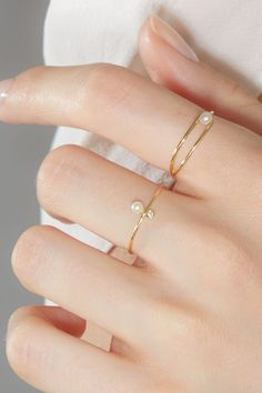 ASTRA RINGS - The contemporary silhouette embraces the bright mirror-like luster pearl to create a sophisticated - Fancy Jewellery, Stylish Jewelry, Simple Jewelry, Cute Jewelry, Fashion Jewelry, Jewellery Rings, Bulgari Jewelry, Diamond Jewellery, Dainty Jewelry