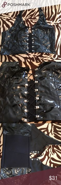 Black patent leather lace up halter top plus size This super sexy black patent leather lace up halter top has silver studs around the neckline silver grommets to lace up and stretchy back band. Super sexy look very hard to find for the curvy girl Tops Camisoles