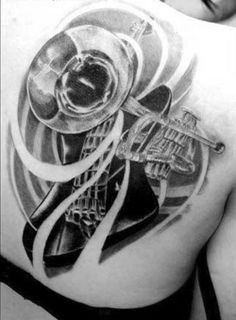 Music tattoo design composed of a trumpet and bass guitar