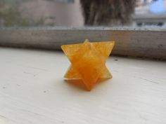 This is a beautiful Yellow Jade crystal merkaba.  It is a fantastic transformative meditation device that also supports the solar plexus chakra.  Learn more at our Etsy shop!