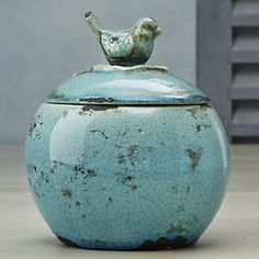 Bluebird Jar | Crafted to resemble a cherished keepsake, this ceramic jar has glazed and unglazed areas, and a distressed, crackled finish.