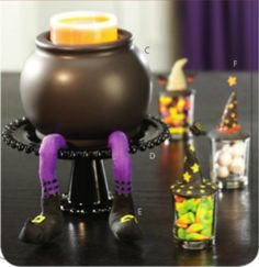 Brewing up a treat for Halloween! Black Knobbed Stand with Cauldron ScentPod Warmer atop our Whimsical Witch Legs.  Shown with Whimsical Witches (Set of 3). #goldcanyon #candles #scentedcandles #scentpodwarmer #scentpod #halloween #cauldron #samhain #legs #witchlegs #witches