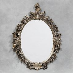 This oval silver wreath mirror is bang on trend and is a clear example of a mirror that would lend itself to either a contemporary or more traditional home décor. The silver finish will successfully add a touch of glamour to your home. Perfect for almost any home décor the