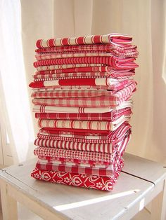 Want this stack of fabric... pretty please : )  Yes, I really need more red and white!