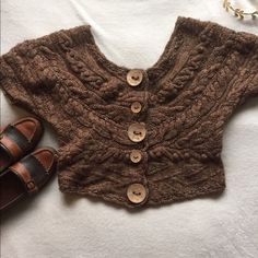 Sleeping On Snow Sweater Crop Top Ultra cozy cropped sweater top from Sleeping On Snow, an Anthropologie brand. Beautifully carved wooden buttons and a slightly open back. Size L but runs small, best for medium or for a looser look on a small. Pair with a flowing maxi skirt and boots for a boho look! ⭐️top only⭐️ Anthropologie Tops Crop Tops