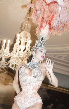 corset (French or Las Vegas? I dont care, I just really love this, complete with feathered headpiece.)