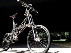 An awesome stainless steel Alex Moulton bike... wow!