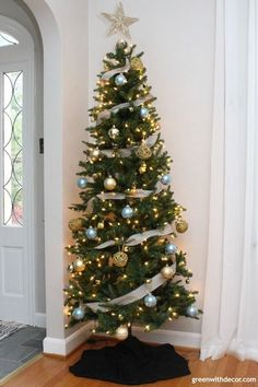 the black gold and blue christmas tree