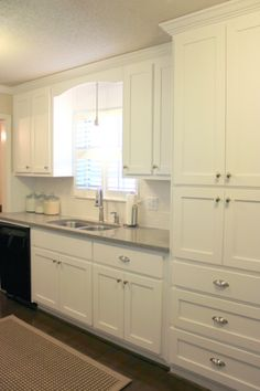 Pantry cabinet in front of chimney, moulding and cabinet layout for around the window above sink