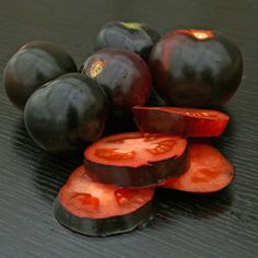 Intriguing purple-black tomatoes are a gorgeous addition to any garden. The fruit darken where exposed to sun, while the undersides of ripe tomatoes show a rich red blush!