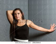 Young healthy female with long hair and toned muscular build