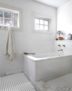 The Westchester ranch home of photographer William Abranowicz features an elegant neutral master bath, with tub and fittings by Waterworks and floor tiles from Ann Sacks. Take the full tour here. Bath Design, Amazing Bathrooms, White Bathrooms, Elle Decor, Kitchen And Bath, White Walls, Decoration, Home Projects, House Tours