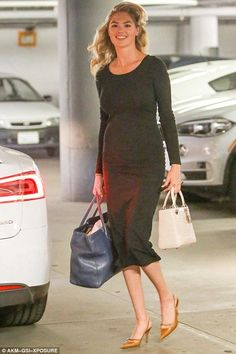 Kate Upton wearing Dior Lady Dior Bag and Chanel Cerf Tote