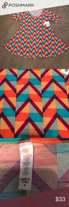 NWT Lularoe perfect tee New Lularoe perfect tee, size medium, see sizing chart for sizing recommendations. Burgundy stripes over a teal and peach block design.  *** PRICE IS FIRM, BELOW RETAIL *** LuLaRoe Tops Tunics