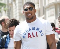 Anthony Joshua sporting a Muhammad Ali T Shirt while greeting fans at the Corinthia Hotel in London