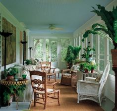 Bunny Williams - tropical sunroom. Note the pale blue ceiling.
