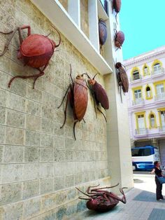 Giant Cockroach Sculptures with human faces by Cuban artist Roberto Fabelo
