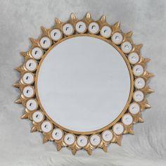 round gold sun mirror