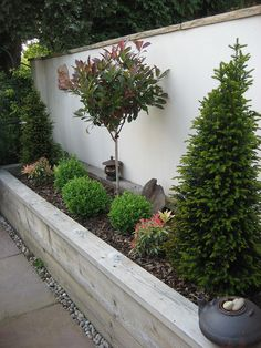 Raised timber sleeper plant border with a concrete block and rendered wall behind, finished with coping stones and painted Front Yard Garden Design, Backyard Garden Design, Small Backyard Landscaping, Back Gardens, Outdoor Gardens, Side Garden, Garden Beds, Landscaping Retaining Walls, Pallets Garden
