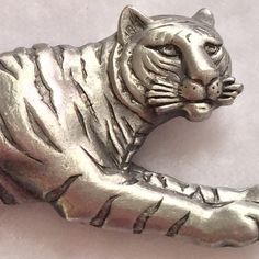 🎀JJ Jonette Sleek Pewter Tiger We buy 98% from small shop auctions all over the USA which dictates our prices. Our Treasures are: >Rare and can not be replaced; >Pre-owned/Used; >Have a Patina due to Age/Wear/Use; >(New unused Treasures are Noted); >Description= (See Pics (Zoom is Available)). We are not experts/Jewelers/Gemologists/Historians/Authenticators. Review pics for any/all defect or deficiency. Please review All Pics carefully and ask questions prior to purchase. All Items Sold as…