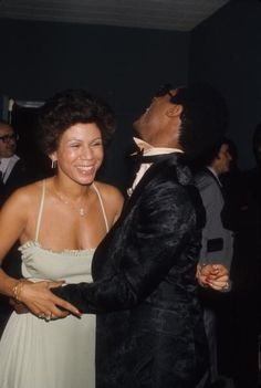 Stevie Wonder shares a laugh with his friend, Minnie Riperton, at a party in 1975. Photo: Michael Ochs Archives/Getty.