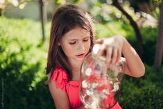 Portrait of a beutiful little girl examining butterflies captured in a jar by paff - Girl, Butterfly - Stocksy United Grandmas Garden, Coral Garden, The Minute, Something Beautiful, Little Girls, Butterfly, Stock Photos, Portrait, Cottage