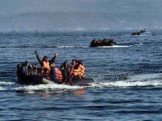 Refugees and migrants aboard dinghies reach the Greek island of Lesbos after crossing the Aegean sea from Turkey. More than half a million people have reached Europe via the Mediterranean this year -- including more than 310,000 landing in Greece, figures from the U.N. refugee agency show.  Aris Messinis, AFP/Getty Images
