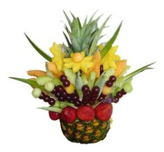 Pineapple Fruit  Floral arrangement originally developed on a pineapple, flowers demargaritas pieces made with pineapple, strawberries and fresh grapes.  Size Large (35 x 25 cm) http://www.compraleflores.com/tienda/product_info.php?cPath=44_id=455
