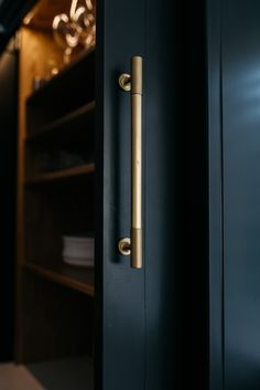 """We are loving these """"off black"""" hand painted pocket doors by . The choice of our burnished brass finished Sparkbrook collection pulls, offers the perfect contrast against the cabinetry. Pocket Door Handles, Pocket Door Hardware, Black Door Handles, Cupboard Handles, Pocket Doors, Brass Kitchen Handles, Door Pull Handles, Drawer Handles, Wardrobe Handles"""