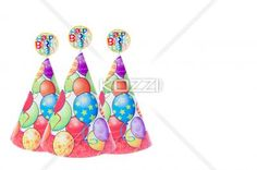 image of birthday caps with happy birthday sign. - Close-up shot of three party hats arranged in a row with happy birthday sign against white background.