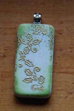 Holiday altered domino pendant  green with gold embossed holly by IridescentDreams, $8.00