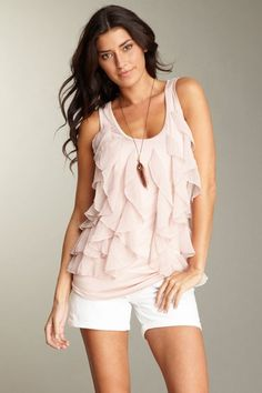 "Disregard the Kim K look-alike.  Romeo and Juliet Couture ""Ruffle Front Knit Tank""."
