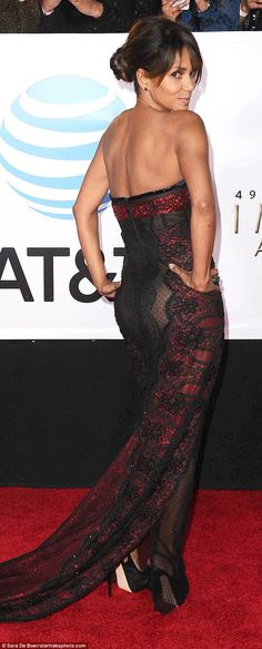 Daring: The strapless number had a dark red embellished bustier bodice and black sheer mat...